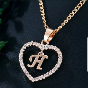 Brand new gold tone letter H necklace
